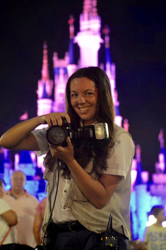 Jenna with the magic kingdom in the background at night
